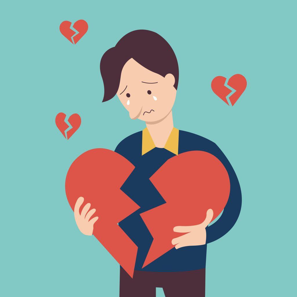 Man holding his broken heart